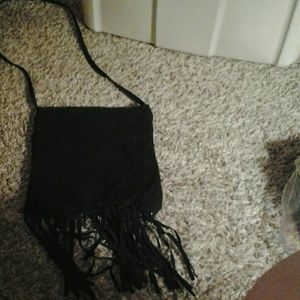 Black suede pures with  fringe  on  the  bottom